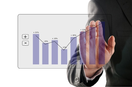 businessman looks at the development of the profit in a chart photo