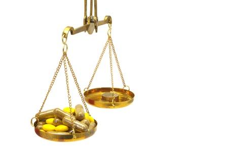 legitimacy: antique balance scale with medicine on white background Stock Photo