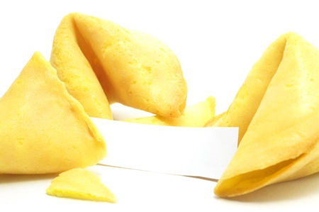 metapher: open fortune cookie isolated on a white background