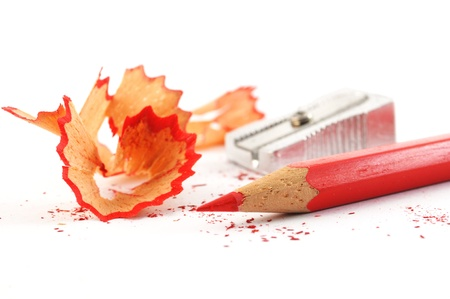 wood shavings: red pencil with shavings isolated on with background