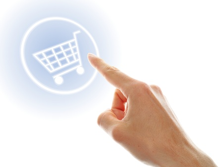 shopping cart button presses by a male hand on white background Stock Photo - 16332660