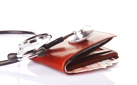 affliction: financial health concept, a stethoscope on brown wallet with money Stock Photo