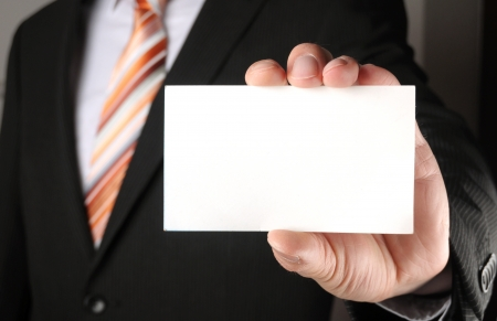 visit card: business man showing blank business card or sign