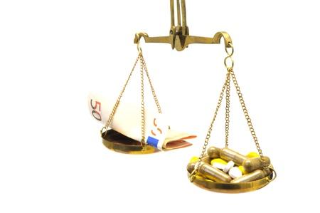 legitimacy: antique balance scale with medicine and money on white background