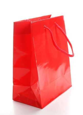 a red shopping bag isolated on white background photo