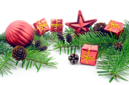 christmas bulbs: christmas decoration with branches, balls, presents and cone. isolated on white background Stock Photo