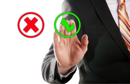 businessman touches of the button right in front of white background photo