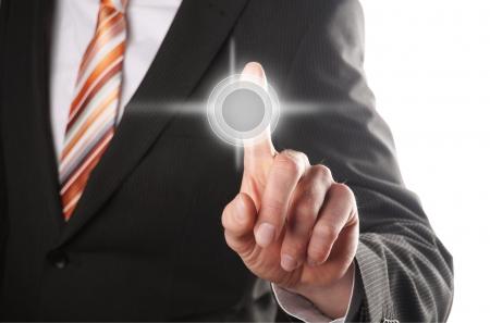 press button: hand from a businessman pressing a tuchscreen button Stock Photo