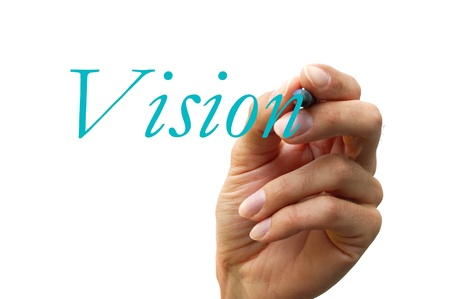 hand writing the word vision isolated on white background Stock Photo