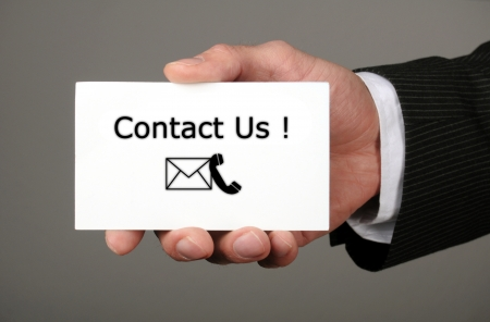 contact info: hand holding business card with the message contact us