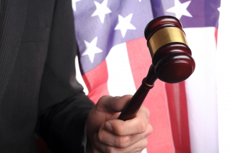 court proceedings: american court, gavel in front of an american flag