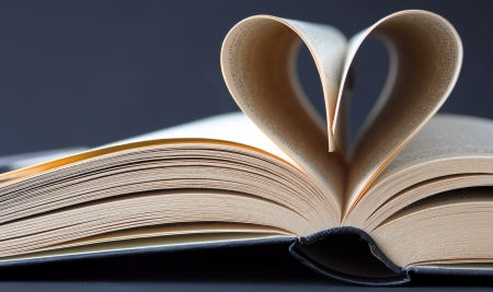 storytelling: open book with pages in the form of a heart