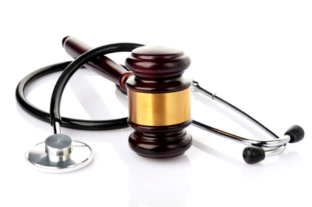 concept about medical lawsuit, stethoscpe and gavel on white background