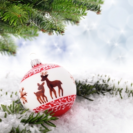 geen: christmas balls with geen branches in front of a abstract background
