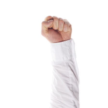 resistence: a clenched fist isolated on white background Stock Photo