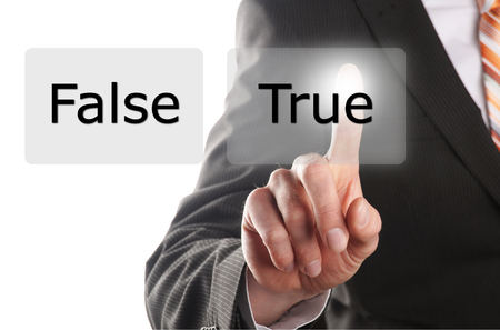 yes or no: businessman presses on the button with the word true