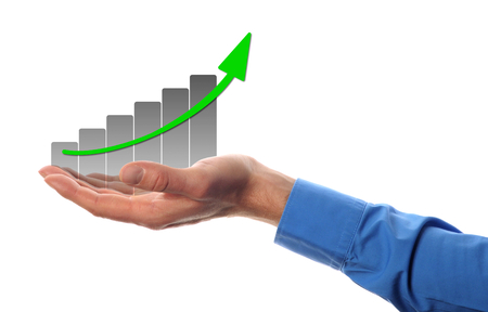 business man hold a chart with increasing beam  photo