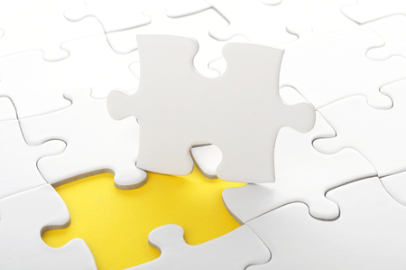 blanck: blanck white jigsaw puzzle with missing piece Stock Photo