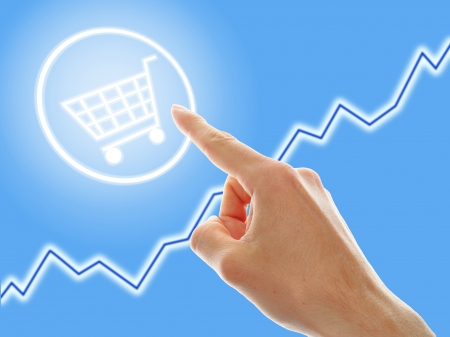 increase sales: concept of growing e-commerce. shopping cart and graph