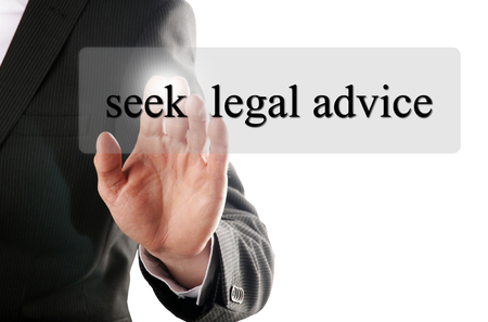 legal advice: man press the button with the message seek legal advice on it
