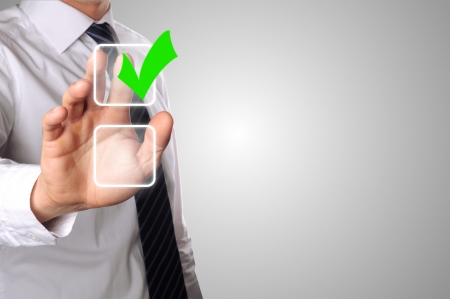 check list: businessman has choosen one of the two options Stock Photo