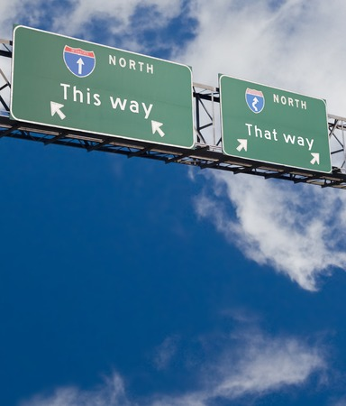fork in the road: Freeway sign giving two choices