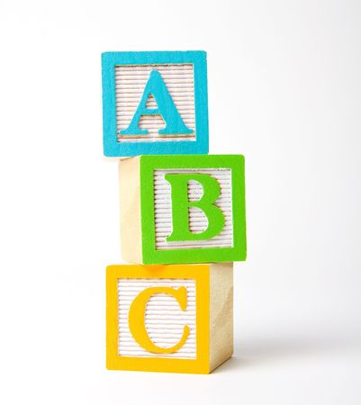 Colorful wooden childrens alphabet blocks stacked upright