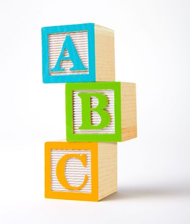 Colorful wooden alphabet blocks stacked with perspective
