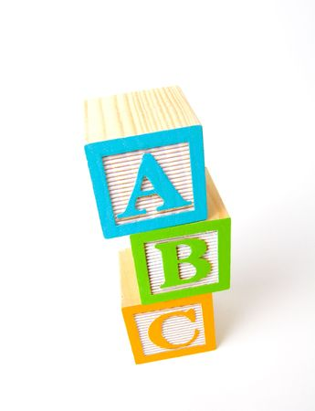 Colorful wooden ABC blocks looking from an angle above