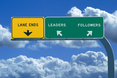 Freeway sign in blue cloudy skies reading Leaders and Followers photo