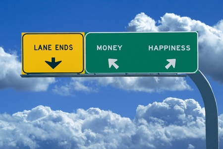 difficult journey: Freeway sign in blue cloudy skies reading Money and Happiness