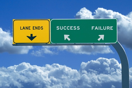 difficult journey: Freeway sign in blue cloudy skies reading Success and Failure Stock Photo