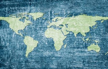 Green world map on blue grunge background Banco de Imagens
