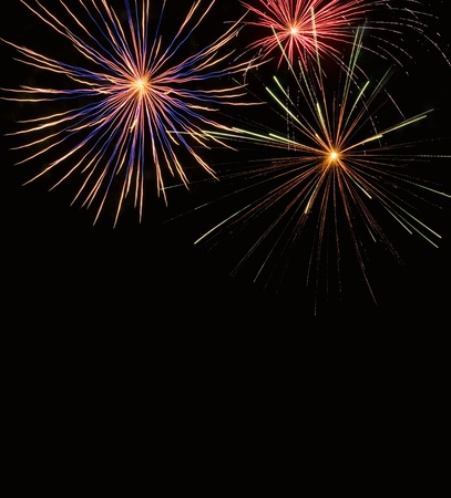 A colorful aerial fireworks display with blank space at bottom