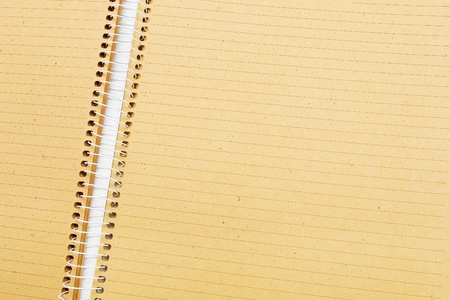 Close-up of open notebook with brown paper