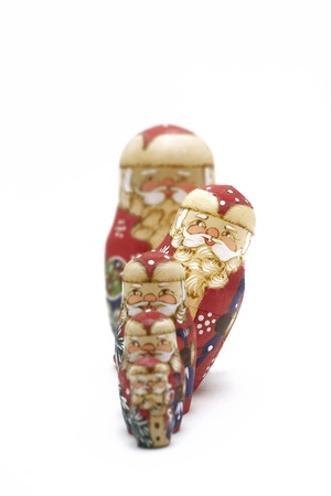 Santa Claus nesting dolls in line photo