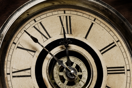 Close-up of the face of an antique grandfather clock built in 1879 - about to strike 12 midnight Stock Photo - 13003933