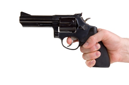 Hand holding a pistol isolated on white
