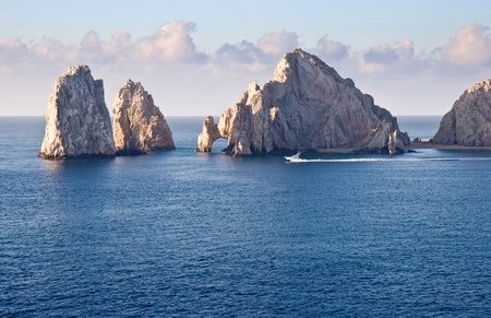 Fishing boat sailing by Los Arcos in Cabo San Lucas, Mexico