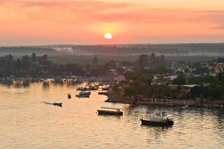 Sailing into Mazatlan harbor during early morning sunrise photo
