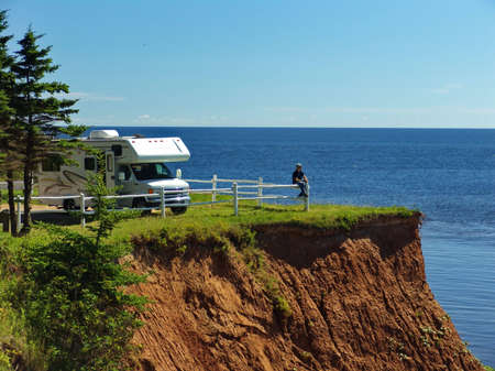 RV vehicle and Traveller on Prince Edward Island, Canada Stock Photo