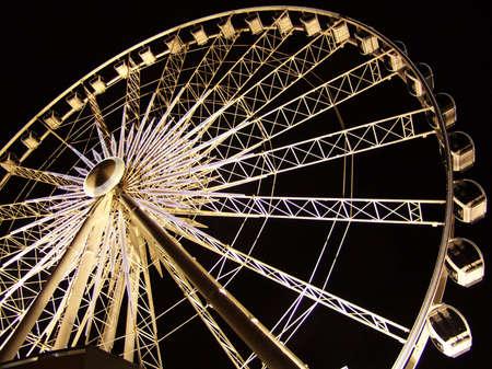 illuminated: Illuminated Ferris Wheel in Dark Stock Photo