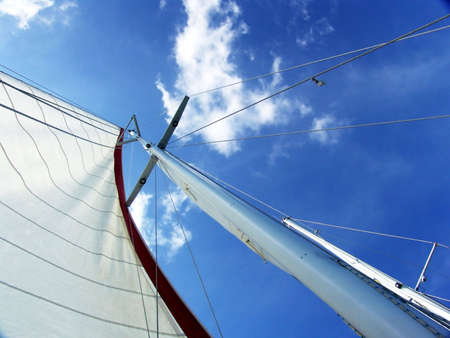 A sailboat mast from below. Blue Sky Background