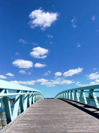 Foot bridge to blue sky, with some white clouds