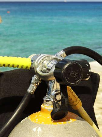 Scuba tank in front of blue Caribbean water 免版税图像 - 2735736