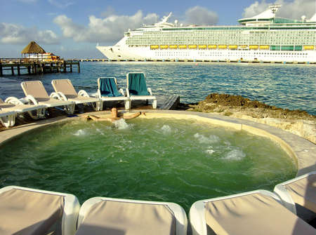 Man relaxing in spa pool on Caribbean Shore