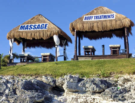 Massage Huts with banner on the roof. Cancun, Mexico Stock Photo