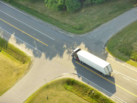 Aerial view of a truck approaching a roads intersection.