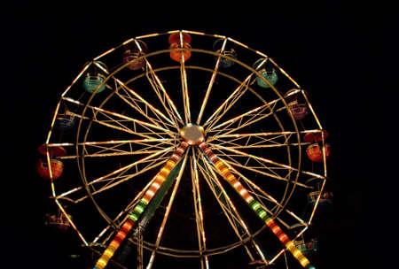 Ferris wheel. Night entertainment.
