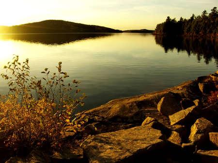 Dramatic sunset at lake. Autumn, October. Algonquin Provincial Park, Ontario, Canada. photo